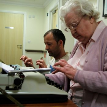 Resident Theresa at her typewriter