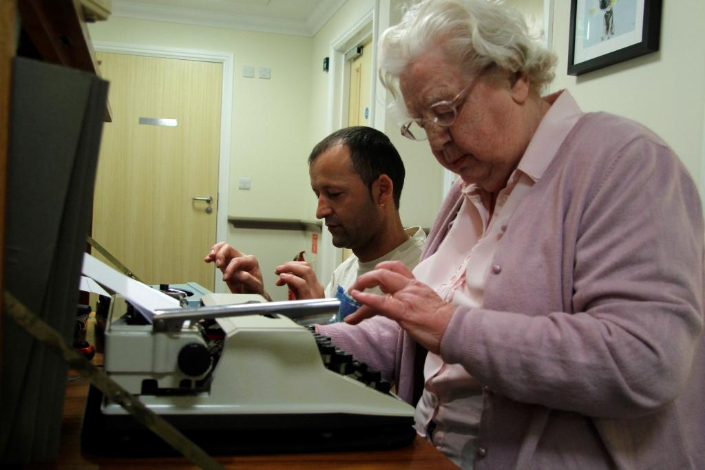 Resident Theresa at her typewriter