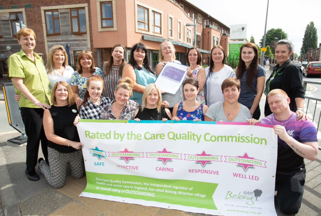 Staff at Belong Atherton celebrate the care village's outstanding inspection report