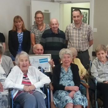 MHA Stratton House residents and staff with their PCC award