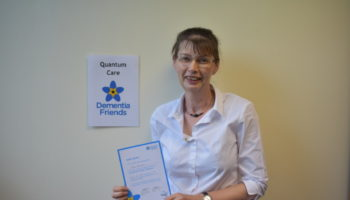 Sue Harrison with her certificate