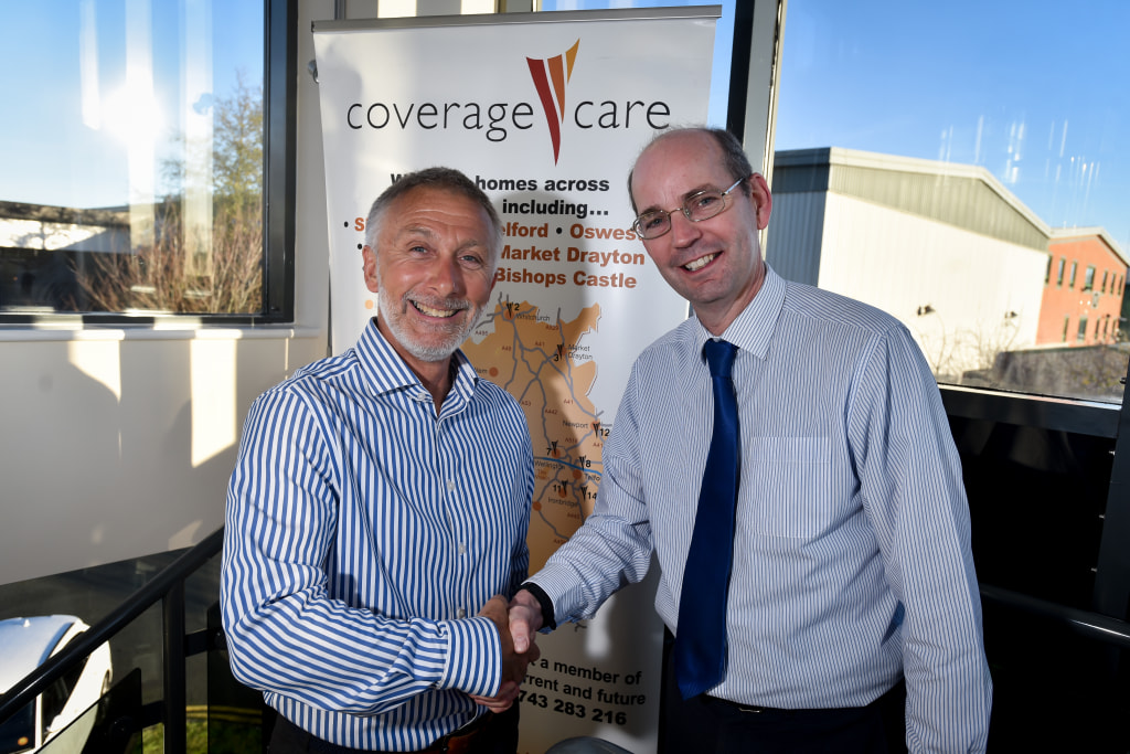 Outgoing CEO David Coull congratulates Chris Wall on his appointment as chief executive of Coverage Care Services