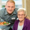 male carer with female resident