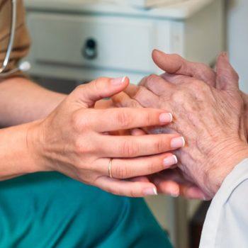 Doctor giving encouragement to elderly patient