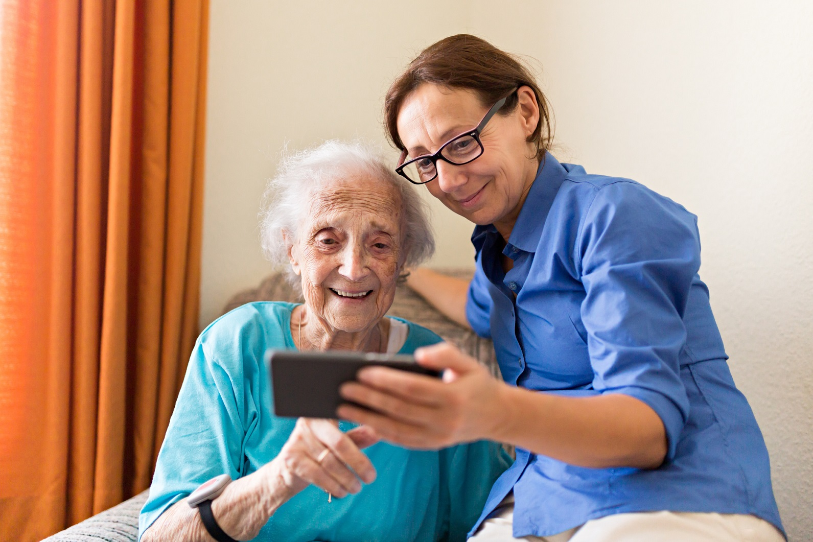 Senior woman with female caregiver