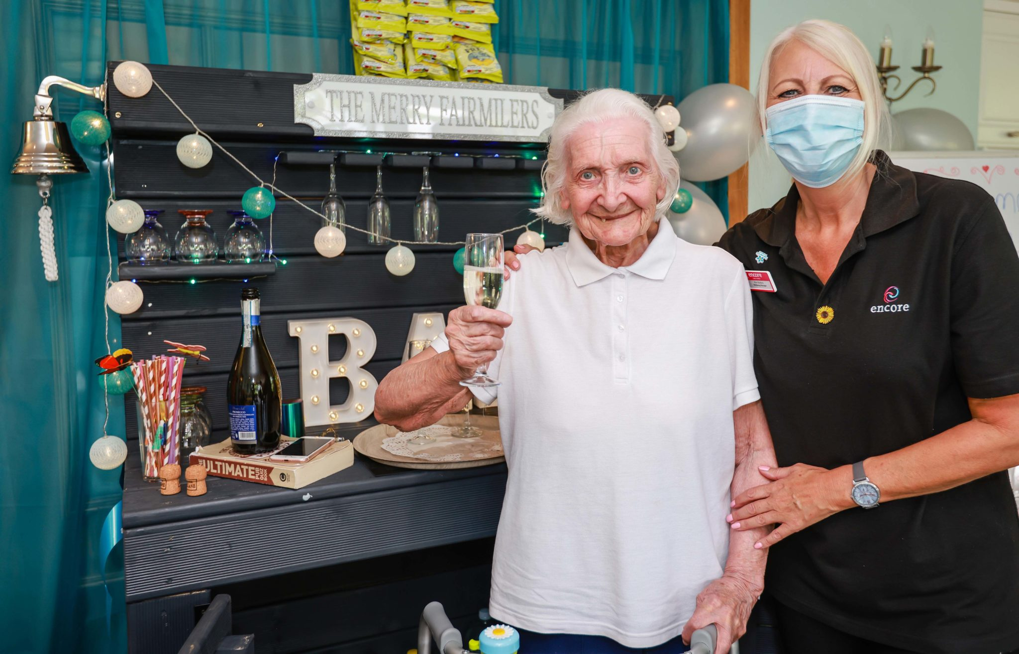 Kim Butters, Wellbeing Manager, with Rita Satchwell enjoying her first drink from the bar